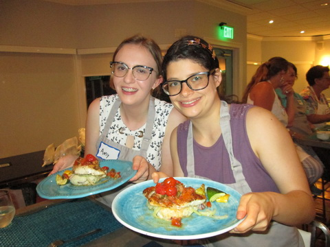 Amy Krueger and Erin Pyper teens enjoy the dinner they cooked at Laidies, Let\'s Go Fishing cooking class_resize