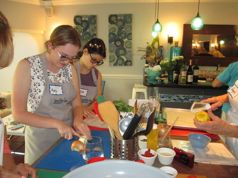 Teens Amy Krueger and Erin Pyper prepare for cooking fish at Ladies, Let's Go fishing cooking class_resize