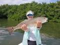 Noelle-Goulart-redfish-w-Capt.-Stewart-Ames-Gone-Fishing-Charters_resize